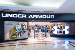 Under Armour store in Suria KLCC mall, Kuala Lumpur. KUALA LUMPUR - JUNE 15, 2016: A view of the Under Armour store in the Suria KLCC shopping mall. Under Armour Royalty Free Stock Image