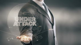Under Attack Businessman Holding in Hand New technologies. Businessman in the future with futuristic technology stock footage