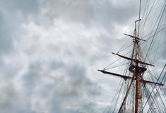 Under Bare Poles. Everything surrounded this sailing vessel is soaked off with stormy foreboding feeling. Usually flaunted and wearing upscale clothing, now the stock images