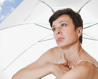 Under a beach umbrella Royalty Free Stock Photography