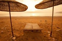 Under a beach umbrella, Honeymoon at Sea Stock Photography