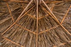 Under the beach umbrella Stock Images