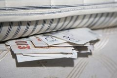 Under the bed. Cash hidden under the mattress Stock Photo