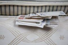Under the bed. Cash hidden under the mattress Royalty Free Stock Photos
