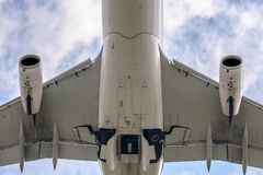 Under a big jet plane Royalty Free Stock Images