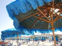 Under a Blue Beach Umbrella Stock Photo