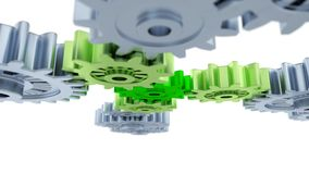 Under Blurred Silver Gears Green and Light Green Gears. On a white background Stock Photos