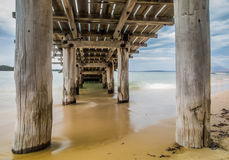 Under the Boardwalk. Under the fishing pier on the Beach Royalty Free Stock Photography