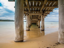 Under the Boardwalk. Under the fishing pier on the Beach Royalty Free Stock Photos
