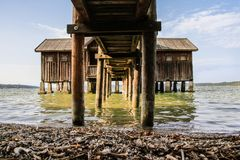 Under the boathouse. View under the pier of a boat house on Lake Ammer Ammersee near Munich in Bavaria, Germany, in summer Stock Photos