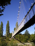 Under the bridge. View from underneath a suspension bridge Royalty Free Stock Photography