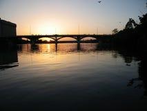Under The Bridge. Original image of a sunset behind a bridge Royalty Free Stock Photos