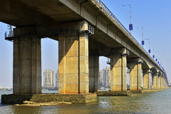 Under the bridge,The bridge across the river,bridge pier. Under the bridge ,A view from under a bridge to the vanishing point.The bridge across the river.under Royalty Free Stock Photos
