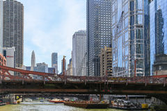 Under the Bridge. Chicago, USA - May 24, 2014: Lasalle street bridge seen from Chicago river with high-rises and boats in the background Royalty Free Stock Photo