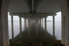 Under the bridge with reflection stock images