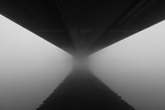 Under the bridge with fog Part 1. Under the bridge with fog.Black & white picture taken one morning in Linz, Austria with strong fog. Extrem wide angel photo of Royalty Free Stock Images