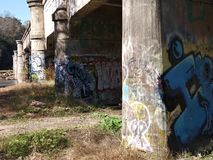 Under the bridge of graffiti stock photography