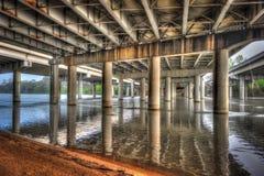 Under bridge on Lady Bird Lake, Austin, Texas. Pylons under bridge over Lady Bird Lake, Austin, Texas stock images