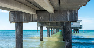 Under bridge looking out to sea Stock Image