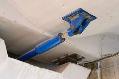 Under bridge massive Hydraulic damper used to dissipate the large amounts of energy that result from sudden dynamic loading like e Royalty Free Stock Image