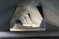 Under the bridge. Nice arches of Singapore concrete bridge, lightened by crooked sun rays Royalty Free Stock Photo