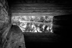 Under the bridge over water. Black and white under the bridge over water in Dorset countryside Stock Photos