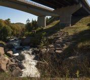 Under bridge with river Royalty Free Stock Photos