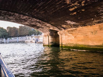 Under a bridge on the Seine River in Paris, France Stock Photos