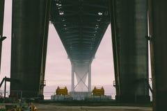 Under bridge shot of bridge in distance with fog Stock Photos
