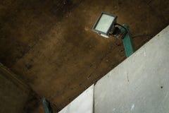 under the bridge. spotlight. wire. cable. dirty. urban. city stock photo
