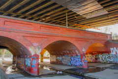Under the Bridge, storm drain. Under a storm drain bridge covered with graffitti Royalty Free Stock Photo