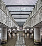 Under a bridge urban water. Royalty Free Stock Photography