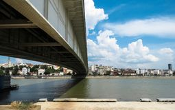 Under the bridge. View on the old Belgrade city,from New Belgrade shore, under the bridge on the Sava river royalty free stock image