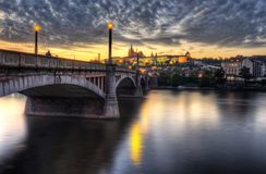Under the bridge. View of old Prague Bridge and Cathedral of Saint Vit Stock Photo