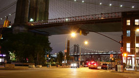 Under brooklyn bridge night light crossroad 4k time lapse nyc stock video footage