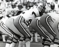 Under Center. Dallas Cowboys QB Roger Staubach, #12 goes under center.  (Image taken from B&W negative Stock Image