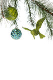Under a Christmas Bough Border. An upper border from the bottom side of a decorated Christmas tree bough.  Besides the pine tree branches it has 2 round bulbs Royalty Free Stock Image