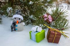 Under the Christmas tree and snowman and gifts stock image