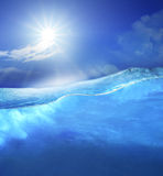 Under clear sea blue water with sun shining on sky above use for