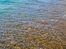 Under the clear sea water visible stones royalty free stock photography