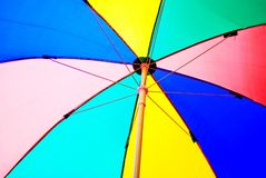 Under colorful beach umbrella Royalty Free Stock Image