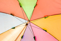Under colorful umbrella Royalty Free Stock Images