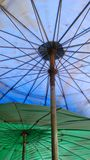 Under the colourful umbrellas on the bright day. Royalty Free Stock Photo