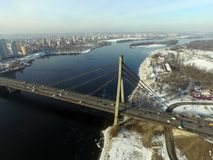 Under Communist occupation builded. Moscow Bridge across Dnepr River, photo from drone at winter. Kiev,Ukraine royalty free stock image