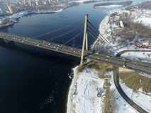 Under Communist occupation builded. Moscow Bridge across Dnepr River, photo from drone at winter. Kiev,Ukraine royalty free stock photography