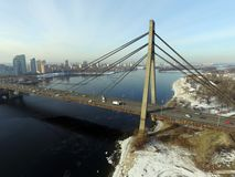 Under Communist occupation builded. Moscow Bridge across Dnepr River, photo from drone at winter. Kiev,Ukraine stock photography