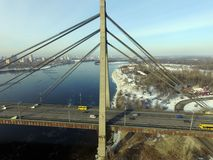 Under Communist occupation builded. Moscow Bridge across Dnepr River, photo from drone at winter. Kiev,Ukraine royalty free stock images