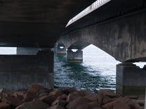 Under a concrete bridge support Stock Photo