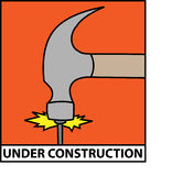 Under Construction. Vector illustration of a hammer driving a nail Royalty Free Stock Photo