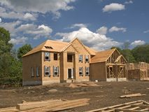 Under Construction. This is a shot of a couple homes in various stages of construction royalty free stock image